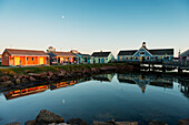 'Spinnakers Landing reflected in tranquil water at sunset; Summerside, Prince Edward Island, Canada'