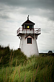 'A red and white lighthouse on the Atlantic coast; Prince Edward Island, Canada'