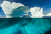 Antarctica, Underwater view of arched Iceberg floating near Enterprise Island on sunny spring morning along Antarctic Peninsula
