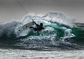 'Kitesurfer on a large wave; Tarifa, Cadiz, Andalusia, Spain'