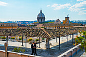 'Priests praying on a rooftop; Rome, Lazio, Italy'