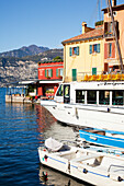 'Boats in the harbour and buildings along the water's edge; Malcesine, Verona, Italy'