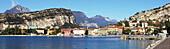 'Cliffs and buildings along the shoreline of Lake Garda; Torbole, Trentino, Italy'