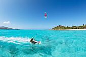 'Professional kiteboarder Susi Mai kitesurfing over the crystal blue waters, Necker Island, British Virgin Islands'