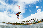 'Professional kiteboarder Chris Burke kiteboarding on the South shore of Maui, Maui, Hawaii, United States of America'