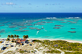 'Aerial view of kiteboarders riding across the crystal clear blue waters, Anegada Island, British Virgin Islands'