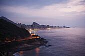 'Lights illuminate the urban coastline; Rio de Janeiro, Brazil'