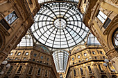 'Ornate interior architecture with a glass domed ceiling; Milan, Italy'