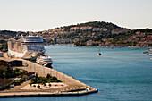 'MSC Fantasia cruise ship moored in the port of Dubrovnik; Dubrovnik, Dalmatia, Croatia'