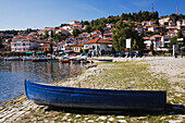 'Blue skiff and boats moored in Ohrid harbour, Lake Ohrid; Ohrid, Macedonia'