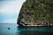 'A boat enters a protected bay on the island of Koh Phi Phi in the Andaman Sea; Thailand'