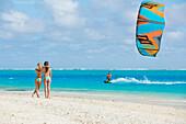 'Kiteboarding in the lagoon over tropical blue water, Bora Bora, French Polynesia'