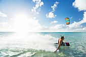 'Kiteboarding in tropical lagoon in the South Pacific, Tikehau, French Polynesia'