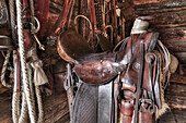 'Saddle and horseback riding equipment at Bar U Ranch National Historic Site; Longview, Alberta, Canada'