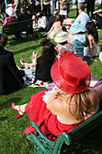 'Hats and fashionable clothes at new Grandstand Enclosure during Royal Ascot horse racing meeting; Berkshire, England'