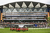 'Military band playing National Anthem prior to Royal procession at the Parade Ring with new Enclosure stand at the Royal Ascot horse race meeting; Ascot, Berkshire, England'