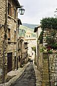 'Stone buildings and narrow street; Spello, Umbria, Italy'