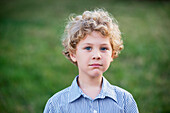 'Portrait of a young boy with blond curly hair and blue eyes; Pittsboro, North Carolina, United States of America'