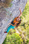 Ines Couto-Sorares, looking for her next move on the route, on a summer day at Margalef.