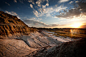 The sun sets in the rugged badlands of Dinosaur Provincial Park in Alberta, on the Canadian prairies.