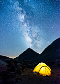 Glowing tent and stars in Royce Lakes area of High Sierra