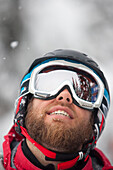 A male skier smiles in Big Sky, Montana.