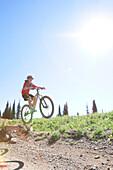 A teenage girl rides her mountain bike in Whitefish, Montana.