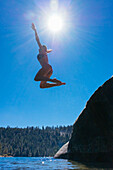 Sabina Allemann is jumping into the clear blue water at Emerald Bay, Lake Tahoe.