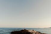 Couple standing on promontory in La Manga, Spain in the region of Murcia.
