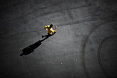 Young man running on the asphalt of the city in Barcelona, Spain.