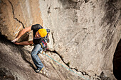 Man lead climbing a two pitches crack route in trad style, where only friends and nuts are allowed to protect the progression. Cadarese is a granite crag located in Premia, Ossola Valley, and is growing to one of the best european destination for trad and