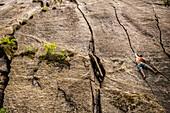 Italian climber trad climbing a crack route in Esigo, Ossola, Italy. Ossola is one of the main destination in Europe for crack climbing.