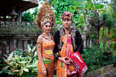 Couple enacting wedding scene in preparation for religious ceremony.Bali. Indonesia