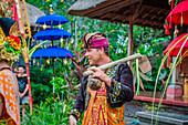 Man enacting wedding scene in preparation for religious ceremony.Bali. Indonesia