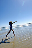 Pre-Teen Girl Running On Beach, Vancouver Island, B.C.