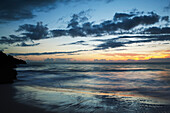 'Afterglow of a sunset on the horizon over the ocean shoreline, Hapuna Beach State Park; Island of Hawaii, Hawaii, United States of America'