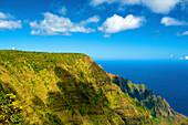 'Rugged green cliffs along the coast; Kauai, Hawaii, United States of America'