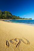 'I love you written in the sand on Tunnels Beach; Kauai, Hawaii, United States of America'