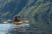 'Kayaking in Gros Morne National Park; Trout River, Newfoundland, Canada'
