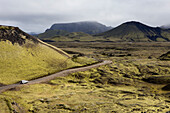 '4 wheel drive vehicle driving down a remote road; Iceland'