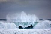 'Dramatic ocean wave off the coast of Southern Iceland near the Blue Lagoon; Grindavik, Iceland'