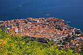 'Old walled city of Dubrovnik overlooking the Adriatic sea taken from Mount Srd; Dubrovnik, Dalmatia region, Croatia'