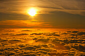 'Sunset viewed above the clouds at Haleakala National Park; Maui, Hawaii, United States of America'