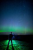 'A photographer captures the Northern lights and shooting star, near Edmonton; Alberta Canada'