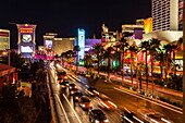 Neon lights, Las Vegas Strip at night with cars leaving light streaks in front of Caesars, Mirage and Flamingo, Las Vegas, Nevada, United States of America, North America