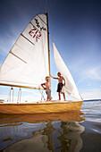 Two boys on a sailing boat, lake Starnberg, Upper Bavaria, Bavaria, Germany