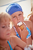 Two girls eating ice cream, lake Starnberg, Upper Bavaria, Bavaria, Germany