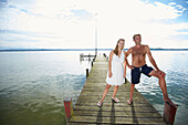 Couple on a jetty at lake Starnberg, Upper Bavaria, Bavaria, Germany