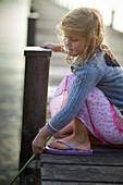 Girl on a jetty, lake Starnberg, Upper Bavaria, Bavaria, Germany