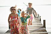 Children on a jetty, lake Starnberg, Upper Bavaria, Bavaria, Germany